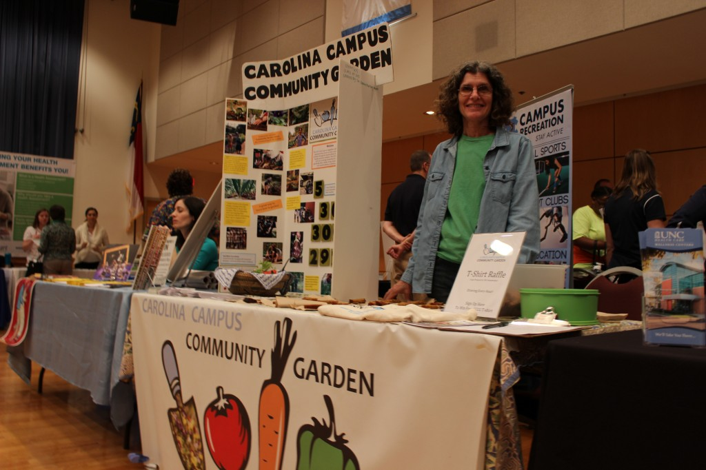 Claire Lorch staffs the Campus Community Garden table